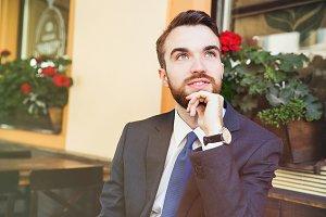 Dreamy businessman with beard