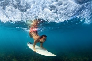 Diving surfer girl