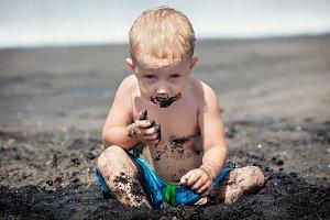 Funny baby boy on the beach