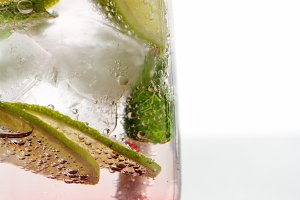 Gin tonic with lime and red fruit