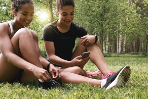Young women sitting in park