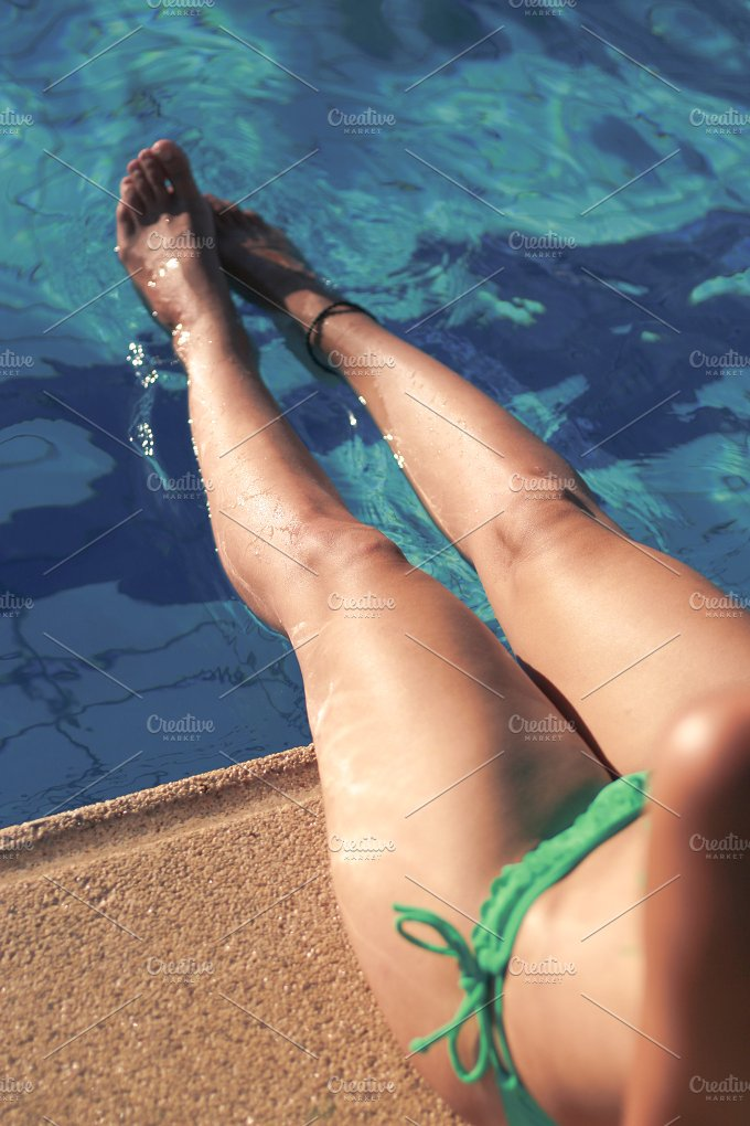 Legs in the pool.jpg - Holidays