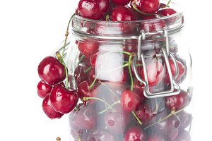 Glass jar with lid full  of cherries
