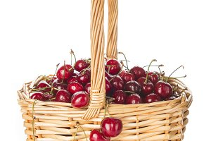 Basket with cherries isolated on a white background