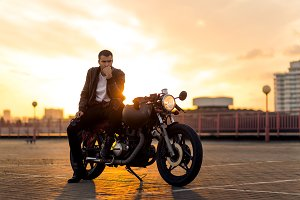 Handsome man with his caferacer bike