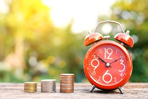 Red alarm clock with coin