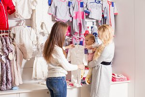 Girls out shopping for clothes