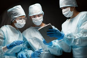Photo of doctors with tablet