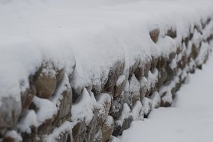 Stone wall in snow