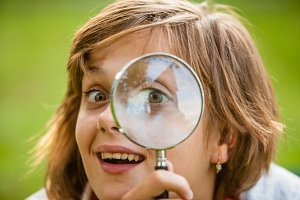 Teenage with magnifying glass
