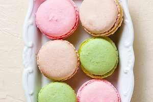 Colourful macaroons on the plates