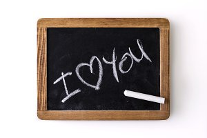"""I love you"" written on a chalkboard"