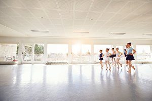 Group of children ballerinas practicing in ballet class