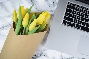 Laptop with yellow tulips