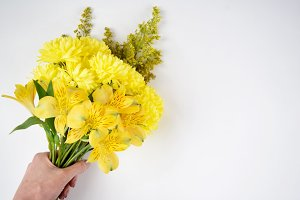 Yellow bouquet in hand