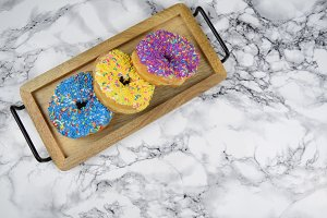 Colorful donuts on platter