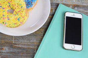 Colorful sprinkle donuts with iPhone