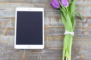 iPad with purple tulips