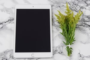 iPad with yellow flowers stock photo