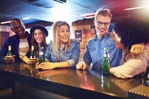 Cheerful people with beer in the bar