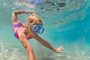Child dive underwater