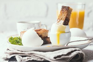 boiled eggs and crispy toasts