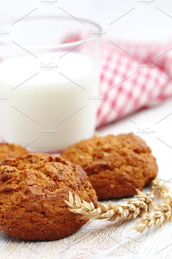 Oatmeal cookies and milk in Illustrations