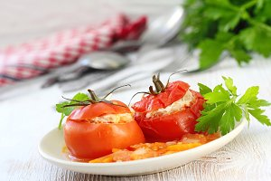 Tomatoes stuffed with meat, rice and vegetables