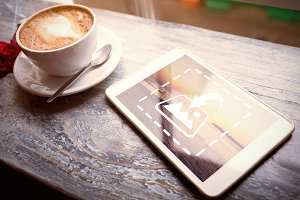 Tablet On Table With Coffee Mockup