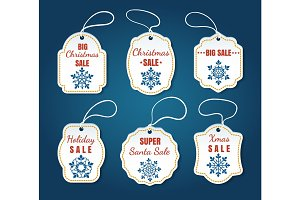 Christmas sale tags on blue background