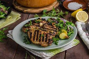Grilled pork chops with lettuce salad