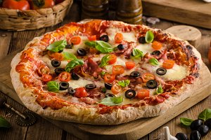 Rustic pizza with tomato, cheese, salami