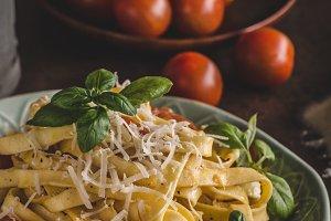 Pasta semolina with tomatoes and parmesan cheese