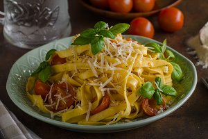 Pasta semolina with tomatoes and parmesan cheese