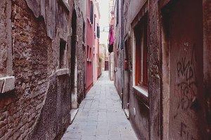 Narrow alley pathway in Venice