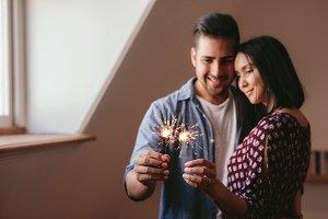 Beautiful young couple celebrating