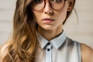Cool hipster girl look to camera.