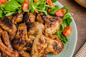 Grilled chicken wings and sausages