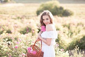 Girl in rose meadow