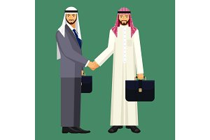 Arabic businessmen in suit and traditional clothing shake hands