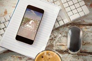 Phone On Notebook & Desk Mockup