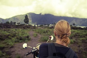 Mountain Girl on a Retro Motorbike