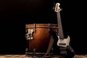 musical instruments, drum bass Bochka bass guitar on a black background