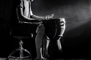 man playing the djembe, african drum, musical concept, beautiful lighting on the stage