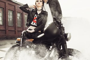 Couple and motorcycle