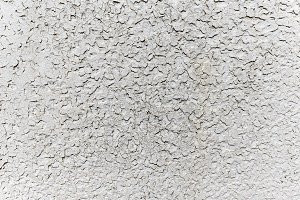 Uneven white grunge concrete wall