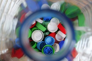 Plastic stoppers into a bottle