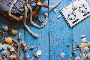 Striped bag and maritime decorations on the wooden background