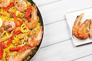 From above dish of paella, typical rice of Spanish food together with prawns.