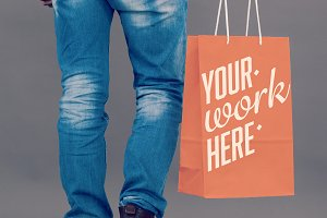 Man Holding Shopping Bag Mockup